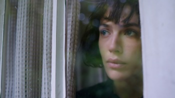 2__TBF Bella (Jessica Brown Findlay) looks out of window